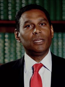 Still from resource video showing man in a suit talking to the camera.
