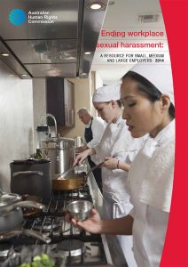 Cover of resource, Ending workplace sexual harassment: a resource for small, medium and large employers, showing two female chefs at work in a kitchen. They're in white uniforms and standing at a stove, cooking.
