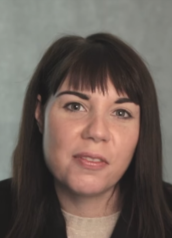 Screenshot from resource video, showing a female journalist interviewee looking at the camera.