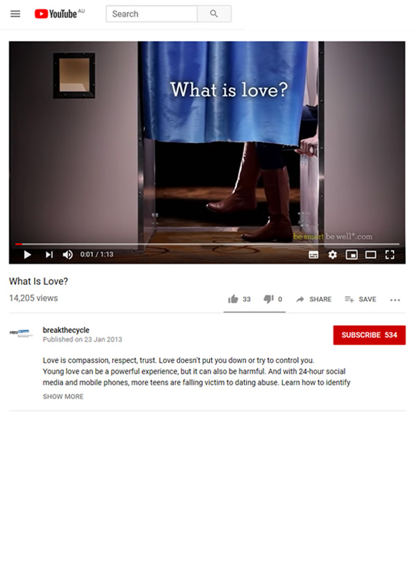 Video still from resource showing a woman's lower legs sticking out from underneath a blue photobooth curtain.
