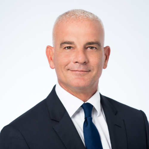 Photo of director John Shepherd. He has short blond hair and is wearing a dark coloured suit and tie.