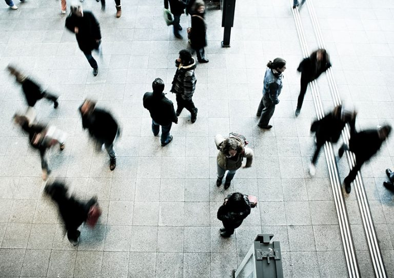 View from above of people walking in a city.